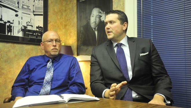 Bucyrus Fire Chief Jay Keller, left, and Attorney Adam Stone discuss Keller's case in October 2017.