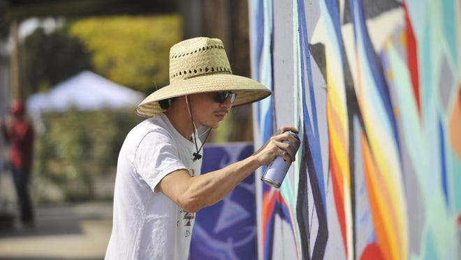 Jose Garcia was one of 70 arts to showcase their work during the 8th annual Taste the Arts festival in downtown Visalia.