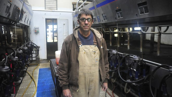 Kent Stuckey stands Monday in his Crawford County milking parlor.