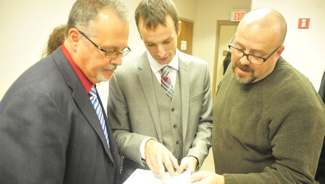 From left, Mark Makeever, Doug Foght and Kevin Myers look over election results to see that they won their Bucyrus City Council races on Tuesday night.
