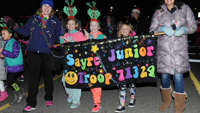 The Sayre Elementary School Girl Scout Junior Troop #71324 is all smiles as the take part in the Cool Yule Parade.