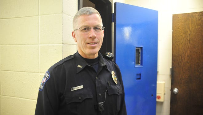 Officer Sam Caldwell stands outside the holding cell at the Bucyrus Police Department.