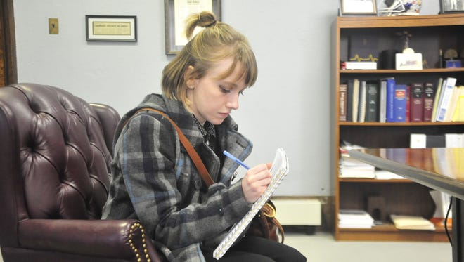 Olivia Minnier, a new reporter for the Telegraph-Forum, takes notes while meeting Crawford County Common Pleas Judge Sean Leuthold on Monday.
