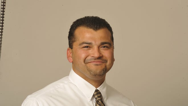 Visalia's Adam Valencia is the new Mt. Whitney High head football coach.