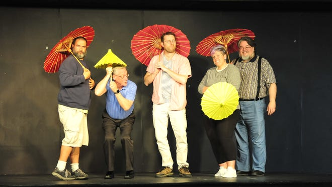 "Members of the ""Four Klunkers and a Chevy"" improv sketch comedy group practice for a previous performance."