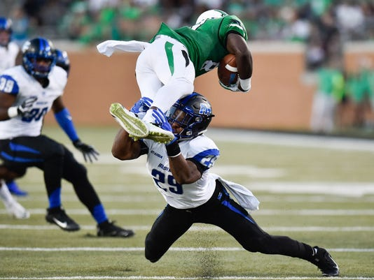 Middle Tennessee sophomore safety Darryl Randolph (29) tackles North Texas freshman wide receiver Tyler (83)