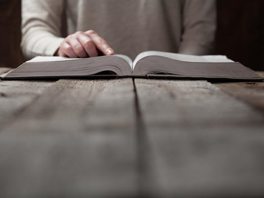 Woman reading a Bible and following with her finger