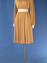 """The dress worn by former first lady Betty Ford during a 1975 """"60 Minutes"""" interview with Morley Safer is among the more than 150 items making up the """"In Step with Betty Ford"""" exhibit."""