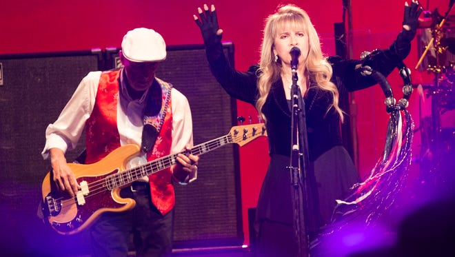 John McVie and Stevie Nicks perform with Fleetwood Mac during a concert at U.S. Airways Center in Phoenix, Ariz. December 10, 2014.