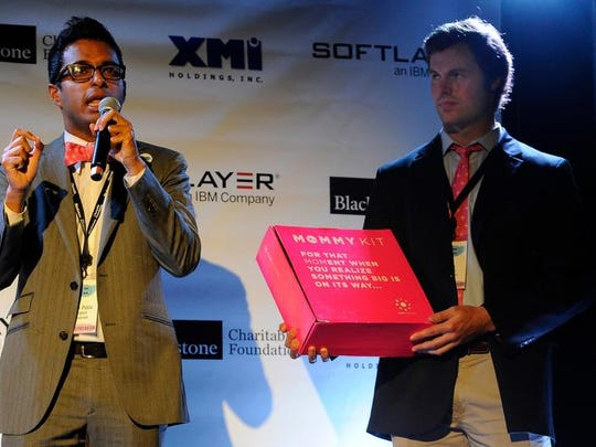 Anish Sebastian and Ross Powell of Babyscrips pitch their company in a 90-second rapid-fire presentation at the 36/86 tech conference at Marathon Music Works on Tuesday in Nashville