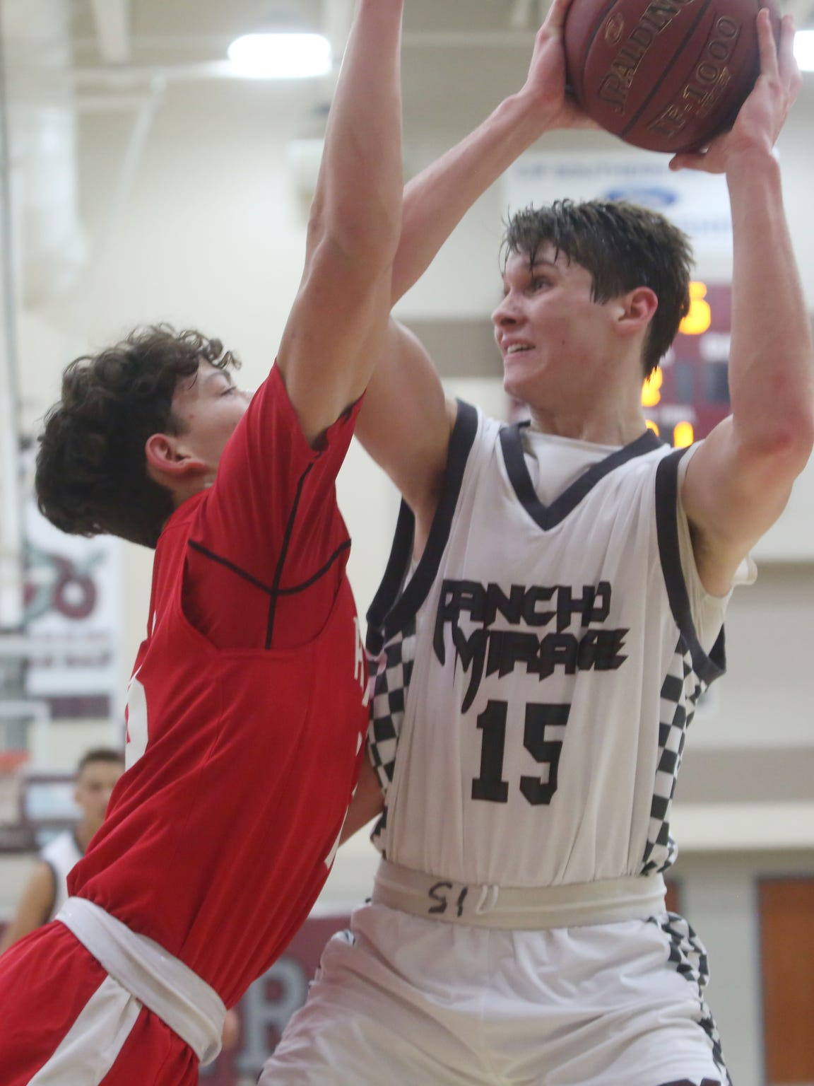 Rancho Mirage High School's Bryan Talley tries to take a shot in the paint against Palm Desert during their game at Rancho Mirage.