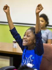 JaShanti Butts, 9, gets excited at the start of Troop 49632's weekly meeting at Community Matters in Lower Price Hill.