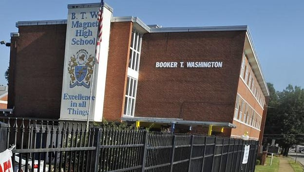 A banner reading We Will never Forget 9-11-01 hangs at Booker T. Washington Magnet High School in Montgomery, Ala. on Friday September 9, 2011.(Montgomery Advertiser, Mickey Welsh)