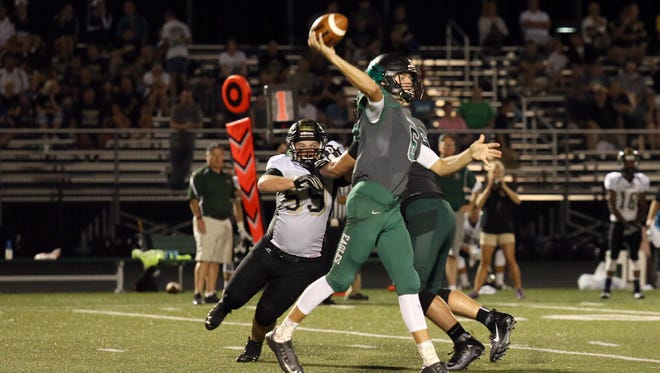 Blake Levy of Zionsville throws a pass against Lebanon.