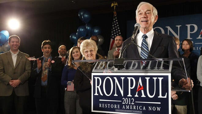 Republican presidential candidate, Rep. Ron Paul, R-Texas, speaks to his supporters during a caucus night party at the Courtyard Marriott hotel in Ankeny on Tuesday, January 3, 2012.