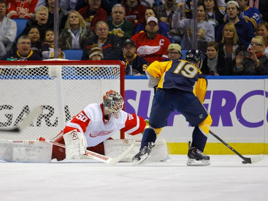 Buffalo Sabres center Cody Hodgson (19) scores a goal on Detroit Red Wings goalie Jonas Gustavsson (50) during the first period at First Niagara Center.