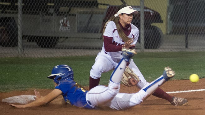 Aggies third baseman Emma Adams gets handcuffed by the throw as CSU Bakersfield's Julea Cavazos slides headfirst into the base Friday night at the NMSU Softball Complex.