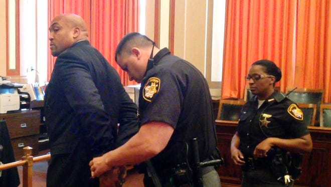 Darrell Beavers is handcuffed to go to prison after the former Cincinnati police officer was convicted.