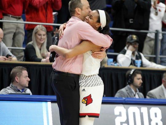 Louisville's head coach Jeff Walz, left, hugs Asia Durr in the closing moments of an NCAA women's college basketball tournament regional final against Oregon State, Sunday, March 25, 2018, in Lexington, Ky. Louisville won 76-43.(AP Photo/James Crisp)