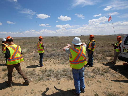 BHP Billiton employees and guests on May 26 tour a section of the Navajo Mine in the Chinde Reclamation area near Fruitland.