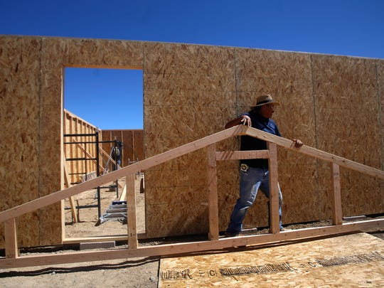 Construction worker Delbert Nez works on a roofing frame Thursday as part of a construction project at the Shiprock Fairgrounds.