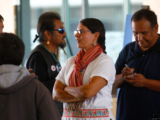 Virginia Necochea, executive director of the Center for Social Sustainable Systems, talks on Monday during an Indigenous Peoples Day celebration at San Juan College in Farmington.