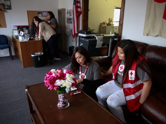 Volunteers Leann Charlie, left, and Malia Simon work on Thursday at the American Red Cross office in Aztec.