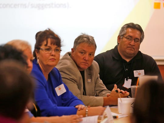 From left, Bloomfield School District Superintendent Kim Mizell, San Juan County CEO Kim Carpenter and Farmington Municipal School District Deputy Superintendent Phil Valdez listen on Oct. 14 during a meeting at San Juan College's School of Energy in Farmington.