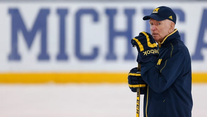 Michigan hockey coach Red Berenson watches practice in Ann Arbor on Tuesday, March 22, 2016.