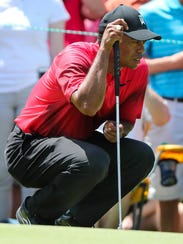 Tiger Woods lines up a putt during the final round