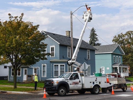 A new LED street light system is installed Tuesday