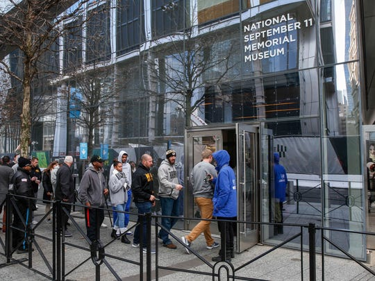 Members of the Iowa Hawkeyes football team enter the September 11 Memorial Museum in New York City on Monday, Dec. 25, 2017.