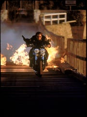 Tom Cruise is a hard man to catch when he's on a bike