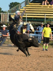 Enquirer reporter Nick Buckley is bucked off a bull