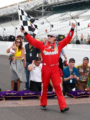 Kyle Busch celebrates his victory at Indianapolis Motor Speedway, his fourth win in five races.