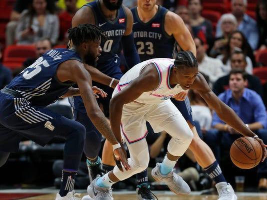 Miami Heat guard Josh Richardson, center, regains control of the ball against Detroit Pistons forward Reggie Bullock (25), center Andre Drummond (0) and forward Blake Griffin (23) during the first half of an NBA basketball game, Saturday, March 3, 2018, in Miami. (AP Photo/Wilfredo Lee)