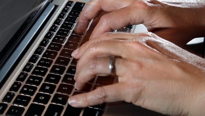 A person types on a laptop keyboard, in North Andover, Mass. The American workplace is grueling, stressful and surprisingly hostile. So finds an in-depth study of 3,066 U.S. workers, released Monday, Aug. 14, 2017, by the Rand Corp., Harvard Medical School and the University of California, Los Angeles.