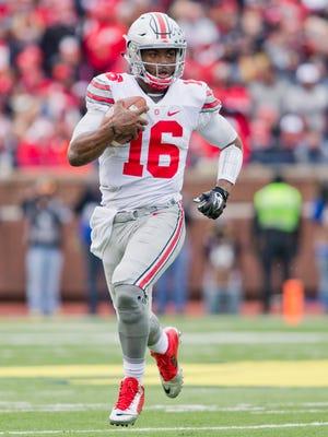 Ohio State quarterback J.T. Barrett (16) runs in the second quarter of an NCAA football game against Michigan in Ann Arbor, Mich., on Saturday, Nov. 28, 2015.