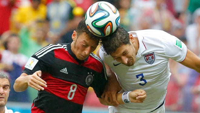 Germany's Mesut Ozil, left, fights for the ball Thursday with Omar Gonzalez of the United States.