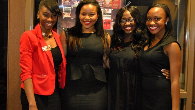 From left to right members of the Black Student Union, Xiomelle Crisistotomo, Taylor Crowley, Ebonique Brooks and Taylor Langley pose at the 28 Shades of Black Opening Ceremonies on Friday, Feb. 1, 2013.