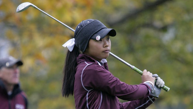 Okemos' Jessica Kim watches her tee shot during the MHSAA Division 2 girls golf finals Saturday, Oct. 18, 2014, in East Lansing, Mich.