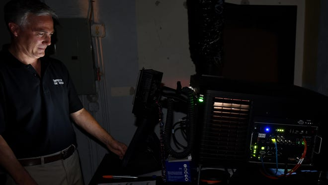 Scott Freeman at one of the theater's two projector rooms at a digital projector..