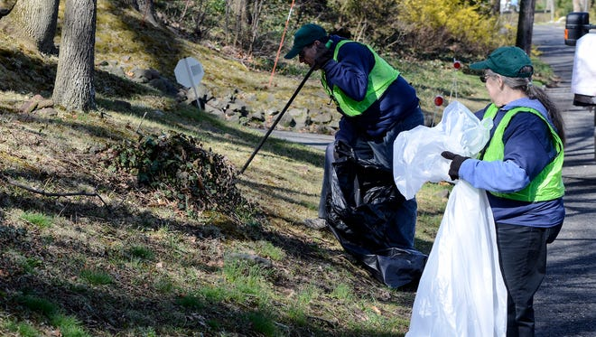 Volunteers pick up trash along Midway Avenue in Fanwood during the annual Community Clean Up event on April 21.