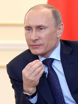 Russian President Vladimir Putin speaks during a news conference in his country residence of Novo-Ogaryova outside Moscow on March 4. Putin on March 4 said that deposed Ukrainian president Viktor Yanukovych had no political future but asserted he was legally still head of state.