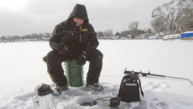 Using a fish finder and an underwater camera, Danny Stricker fishes on Triangle Lake in Howell.