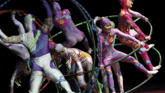 The Golden Dragon Acrobats blend the art of Chinese acrobatics with traditional dance and theatrics to present an engaging stage performance.