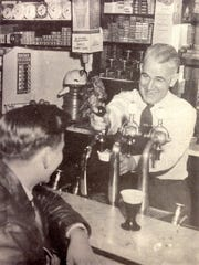 Earl King operating his soda fountain. Photo published in Springfield's Weekly Newsletter on Nov. 29, 1950.