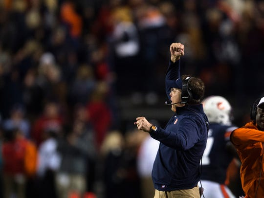Auburn head coach Gus Malzahn celebrates after Auburn