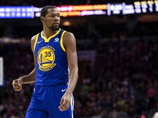 "FILE - In this Nov. 18, 2017, file photo, Golden State Warriors' Kevin Durant pauses during the first half of an NBA basketball game against the Philadelphia 76ers in Philadelphia. Draymond Green and Durant bet on just about anything. ""Life,"" Green explained, ""who drives home faster from the practice facility, who gets to the game earlier. You want us to tell you our whole life?"" KD and Dray have formed quite a bond since way back, when Green was part of the strategic recruiting process to bring Durant to the Bay Area from Oklahoma City before last season. (AP Photo/Chris Szagola, File)"
