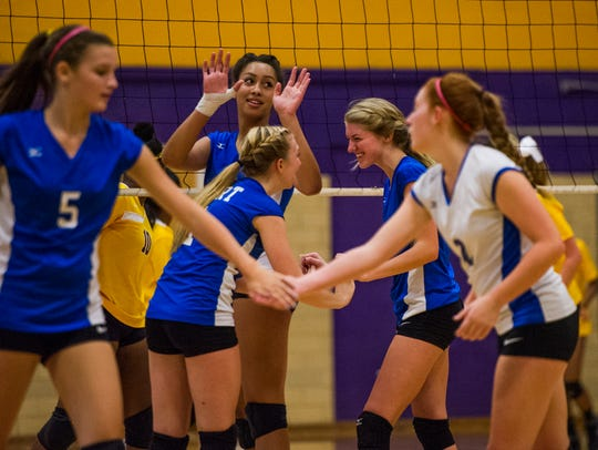 Fort Defiance players celebrate after scoring against